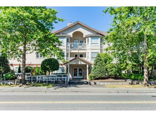"Photo 2: 210 5977 177B Street in Surrey: Cloverdale BC Condo for sale in ""THE STETSON"" (Cloverdale)  : MLS®# R2482496"