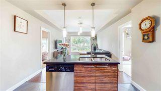 "Photo 10: 210 12039 64 Avenue in Surrey: West Newton Condo for sale in ""LUXOR"" : MLS®# R2497151"