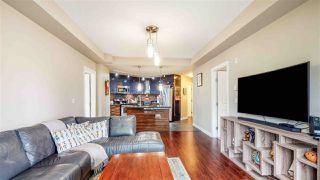 "Photo 9: 210 12039 64 Avenue in Surrey: West Newton Condo for sale in ""LUXOR"" : MLS®# R2497151"