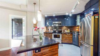 "Photo 11: 210 12039 64 Avenue in Surrey: West Newton Condo for sale in ""LUXOR"" : MLS®# R2497151"