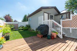 Photo 36: 48 MacEwan Park Road NW in Calgary: MacEwan Glen Detached for sale : MLS®# A1018639
