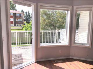 Photo 4: 29 505 Edmonton Trail NE: Airdrie Row/Townhouse for sale : MLS®# A1029452
