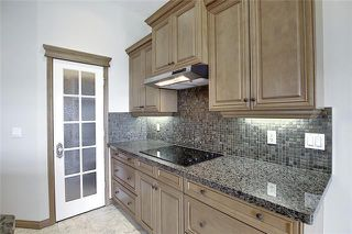 Photo 6: 43 ROCKYLEDGE Rise NW in Calgary: Rocky Ridge Detached for sale : MLS®# C4302946