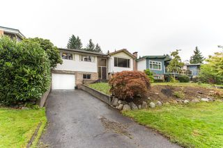 Photo 1: 1212 HEYWOOD Street in North Vancouver: Calverhall House for sale : MLS®# R2404295