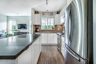 """Photo 5: 107 1135 WINDSOR Mews in Coquitlam: New Horizons Condo for sale in """"BRADLEY HOUSE WEST"""" : MLS®# R2438518"""