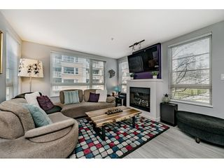 "Photo 3: 204 701 KLAHANIE Drive in Port Moody: Port Moody Centre Condo for sale in ""THE LODGE AT NAHANNI"" : MLS®# R2447172"