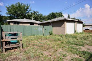 Photo 10: 12807/12809 124 Street in Edmonton: Zone 01 House Duplex for sale : MLS®# E4209586