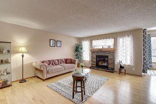 Photo 4: 384 NEW BRIGHTON Drive SE in Calgary: New Brighton Detached for sale : MLS®# A1029027