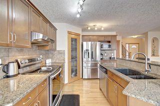 Photo 6: 384 NEW BRIGHTON Drive SE in Calgary: New Brighton Detached for sale : MLS®# A1029027