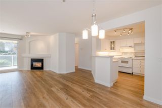 """Photo 1: 102 20125 55A Avenue in Langley: Langley City Condo for sale in """"BLACKBERRY LANE II"""" : MLS®# R2481184"""