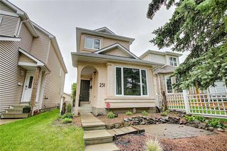 Photo 2: 231 COACHWAY Road SW in Calgary: Coach Hill Detached for sale : MLS®# C4305633
