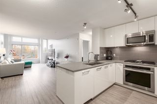 "Photo 1: 404 1128 KENSAL Place in Coquitlam: New Horizons Condo for sale in ""Celadon House"" : MLS®# R2419336"