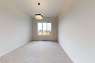Photo 26: 16 Cranbrook Mews SE in Calgary: Cranston Semi Detached for sale : MLS®# A1020393
