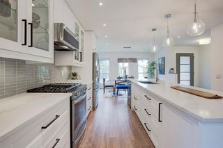 Photo 4: 6012 84 Street NW in Calgary: Silver Springs Detached for sale : MLS®# A1025546