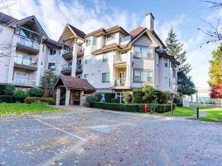 "Photo 1: 102 4745 54A Street in Delta: Delta Manor Condo for sale in ""ADLINGTON COURT"" (Ladner)  : MLS®# R2517301"