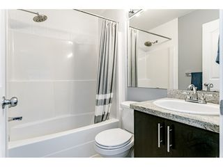 "Photo 14: 28 13899 LAUREL Drive in Surrey: Whalley Townhouse for sale in ""Emerald Gardens"" (North Surrey)  : MLS®# R2435419"
