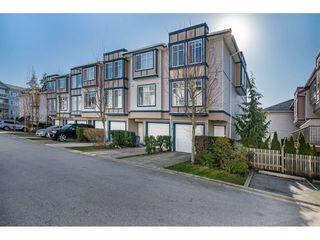 "Photo 1: 28 13899 LAUREL Drive in Surrey: Whalley Townhouse for sale in ""Emerald Gardens"" (North Surrey)  : MLS®# R2435419"