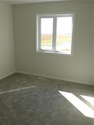 Photo 9: 1 KEN WONG Bay in Winnipeg: Prairie Pointe Residential for sale (1R)  : MLS®# 202012330