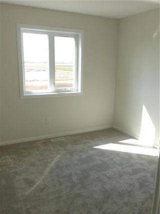 Photo 8: 1 KEN WONG Bay in Winnipeg: Prairie Pointe Residential for sale (1R)  : MLS®# 202012330