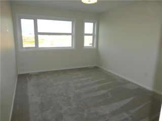 Photo 5: 1 KEN WONG Bay in Winnipeg: Prairie Pointe Residential for sale (1R)  : MLS®# 202012330