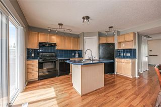 Photo 9: 107 TUSCANY VALLEY Rise NW in Calgary: Tuscany Detached for sale : MLS®# C4303741