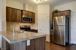 Photo 4: 44 Copperpond Landing SE in Calgary: Copperfield Row/Townhouse for sale : MLS®# A1048100
