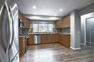 Photo 11: 844 LAKE LUCERNE Drive SE in Calgary: Lake Bonavista Detached for sale : MLS®# A1034964