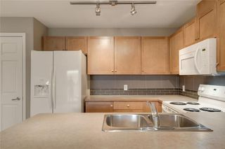 Photo 7: 2106 92 Crystal Shores Road: Okotoks Apartment for sale : MLS®# C4297320