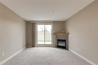 Photo 10: 2106 92 Crystal Shores Road: Okotoks Apartment for sale : MLS®# C4297320