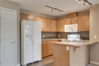 Photo 3: 2106 92 Crystal Shores Road: Okotoks Apartment for sale : MLS®# C4297320