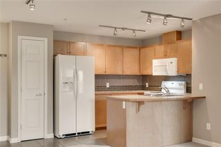 Photo 8: 2106 92 Crystal Shores Road: Okotoks Apartment for sale : MLS®# C4297320