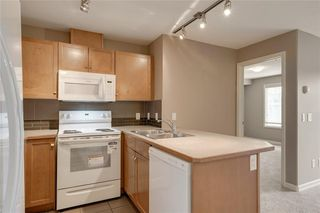 Photo 5: 2106 92 Crystal Shores Road: Okotoks Apartment for sale : MLS®# C4297320