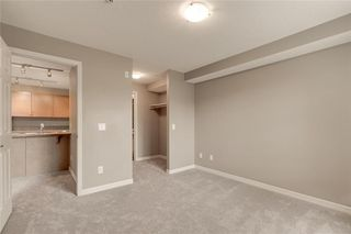 Photo 15: 2106 92 Crystal Shores Road: Okotoks Apartment for sale : MLS®# C4297320