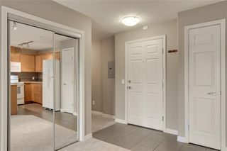 Photo 2: 2106 92 Crystal Shores Road: Okotoks Apartment for sale : MLS®# C4297320