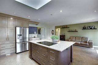 Photo 7: 155 HUNTFORD Road NE in Calgary: Huntington Hills Detached for sale : MLS®# A1016441