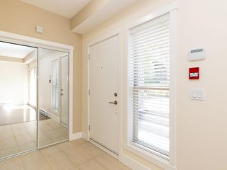 Photo 2: 114 2110 ROWLAND Street in Port Coquitlam: Central Pt Coquitlam Condo for sale : MLS®# R2500858