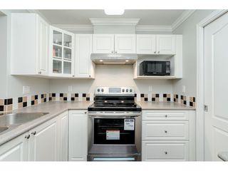 "Photo 13: 407 15210 GUILDFORD Drive in Surrey: Guildford Condo for sale in ""Boulevard Club"" (North Surrey)  : MLS®# R2420347"