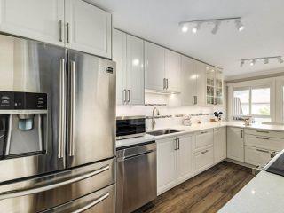 """Photo 1: 306 14993 101A Avenue in Surrey: Guildford Condo for sale in """"Cartier"""" (North Surrey)  : MLS®# R2495846"""