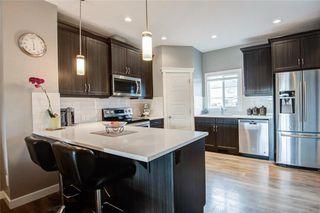Photo 3: 320 WILLOW Street: Cochrane Semi Detached for sale : MLS®# C4261011