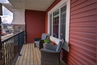 Photo 2: 320 WILLOW Street: Cochrane Semi Detached for sale : MLS®# C4261011