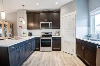 Photo 4: 320 WILLOW Street: Cochrane Semi Detached for sale : MLS®# C4261011