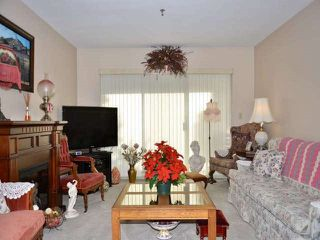 """Photo 2: 211 33535 KING Road in Abbotsford: Poplar Condo for sale in """"Central Heights Manor"""" : MLS®# R2437846"""