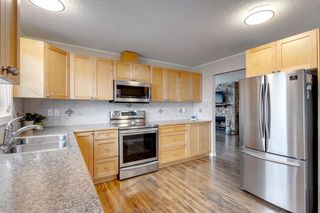Photo 4: 195 Ranchridge Drive NW in Calgary: Ranchlands Detached for sale : MLS®# A1059846