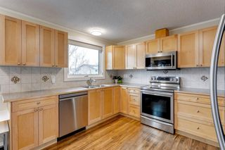 Photo 5: 195 Ranchridge Drive NW in Calgary: Ranchlands Detached for sale : MLS®# A1059846