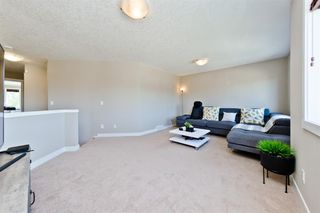 Photo 15: 125 COUGARSTONE Manor SW in Calgary: Cougar Ridge Detached for sale : MLS®# A1019561