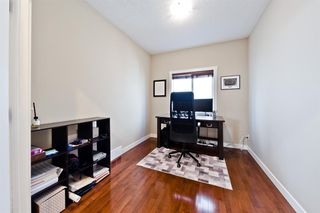 Photo 10: 125 COUGARSTONE Manor SW in Calgary: Cougar Ridge Detached for sale : MLS®# A1019561