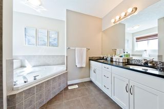 Photo 21: 125 COUGARSTONE Manor SW in Calgary: Cougar Ridge Detached for sale : MLS®# A1019561