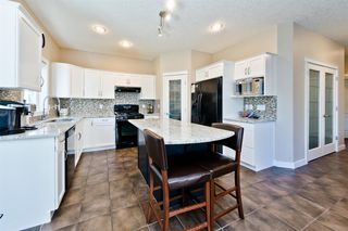 Photo 6: 125 COUGARSTONE Manor SW in Calgary: Cougar Ridge Detached for sale : MLS®# A1019561