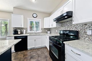 Photo 7: 125 COUGARSTONE Manor SW in Calgary: Cougar Ridge Detached for sale : MLS®# A1019561