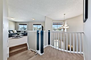 Photo 13: 125 COUGARSTONE Manor SW in Calgary: Cougar Ridge Detached for sale : MLS®# A1019561